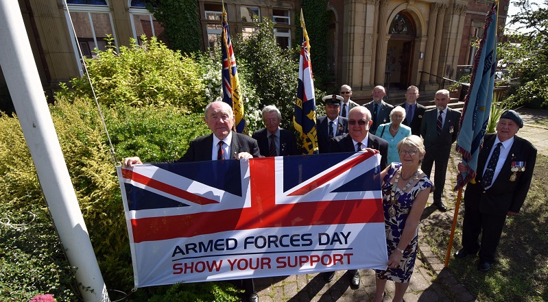 Members of the Royal British Legion and Armed Forces veterans join Eden District Council Councillors to raise a flag for Armed Forces Day.