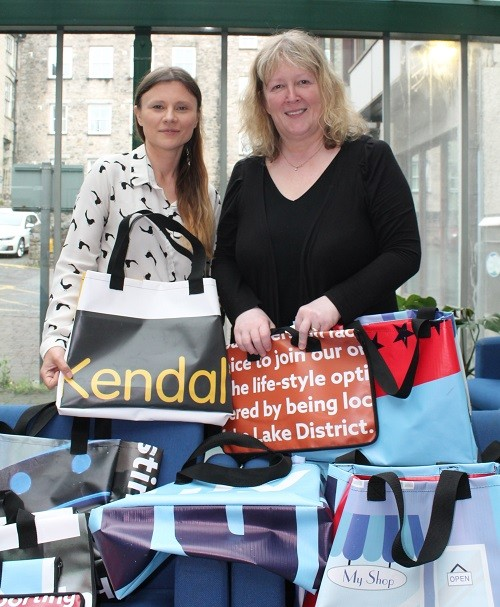 Project officer Anna Brisley and Councillor Dyan Jones, Portfolio Holder for Climate Emergency and Localism, with some of the bags upcycled from banners
