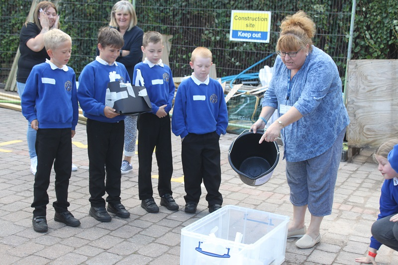 Pupils from Distington Community school wait in anticipation to see if their boat sinks