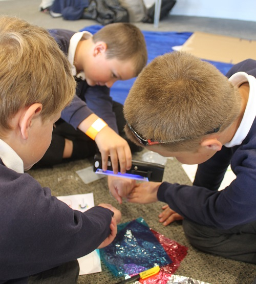 Pupils from Seascale Primary School experiment with UV light