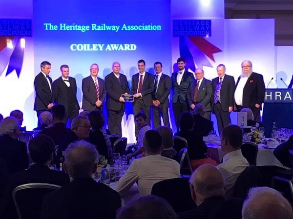 The Ravenglass and Eskdale Railway Preservation Society receiving the Coiley Award from Pete Waterman, OBE at the Heritage Railway Association Awards