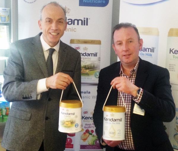 Ross Mcmahon and James Airey holding the two cans of Kendamil & Kendamil Organic Infant formula which helped secure the multi-million-pound trade deal.