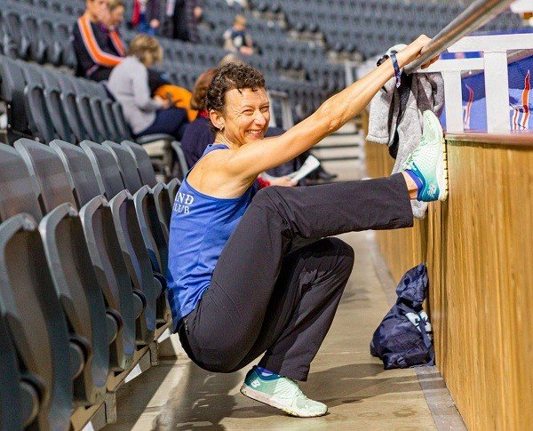 Samantha Ayers stretching before her race at the 2019 British Rowing Indoor Championships. Picture: Drew Smith Photography