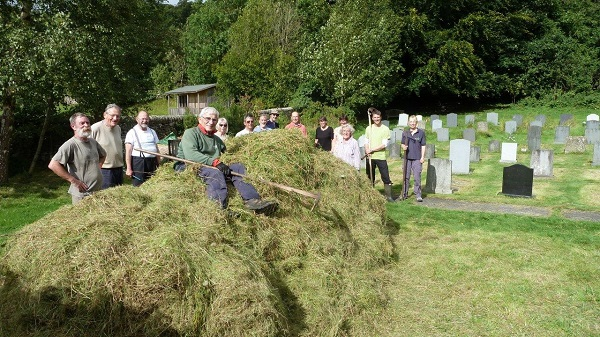 St Alkelda's meadow, Giggleswick - The group had spent the day raking up the hay that had been previously cut and scythed. Photo by Wendy Carroll