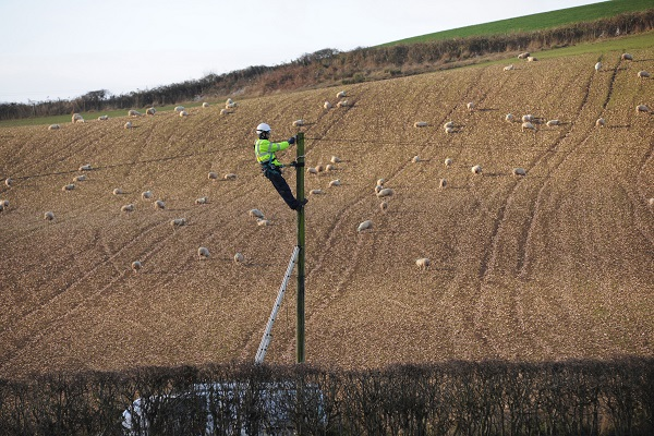 Openreach engineer Alan Lane working on a telegraph pole for Connected Cumbria near St Bees.