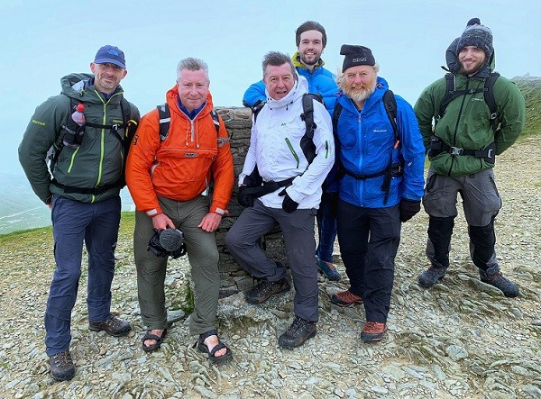 L-R: Tom Jacobs (drone pilot), Terry Abraham, broadcaster Stuart Maconie, Paul Bacon, guide and Lakeland legend David Powell-Thompson and Nathan Buckley. On the summit of Helvellyn after filming Stuart tackling Striding Edge for the first time.