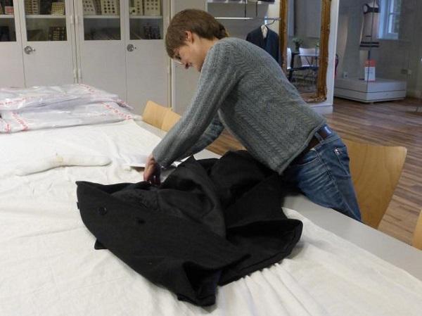 Textile artist Heather Belcher measuring Mayer Hersh's coat at Gallery of Costume, Platt Hall, Manchester. Courtesy LDHP/Platt Hall