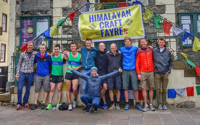 The full team (minus Danny Jones) celebrate at the Moot Hall Finish with organiser Clare Kent (front)
