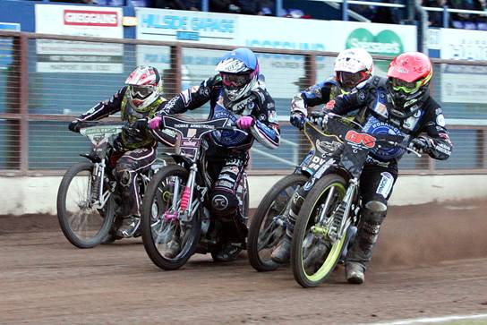 Thomas Jorgensen (blue helmet) and Craig Cook (red) put the first turn squeeze on Berwick's Nick Morris (white) in heat 13 at Derwent Park last Saturday! (photo: Dave Payne)