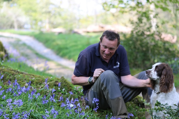 Tim Berry from English Lakes Hotels with Lily the dog and the white bluebell