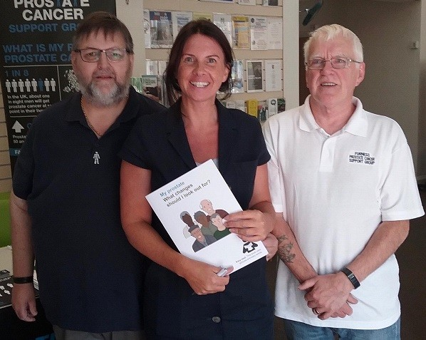 Trudy Harrison with David Nutter (left) support group chairman and Tony O'Malley