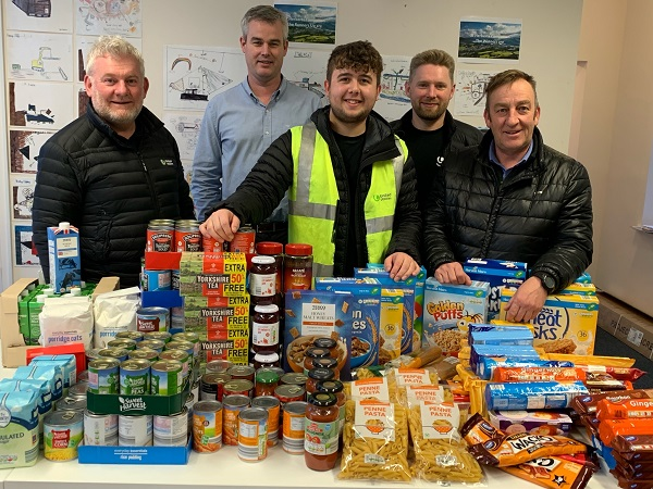 Some of the food donated by United Utilities staff in Cockermouth (L-R) project director John Hilton, principal project manager Glenn Mallinson, assistant project co-ordinator Luke Johnston, project manager Ian Tomlinson and construction delivery manager John Parr.