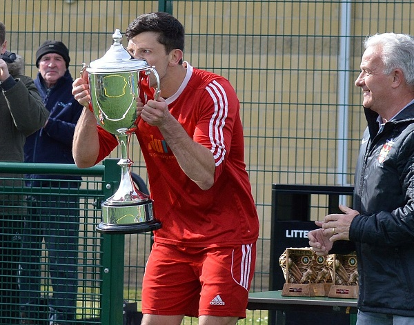 Workington Athletic's skipper Tom Pardini kisses the League Trophy (Linda Perry)