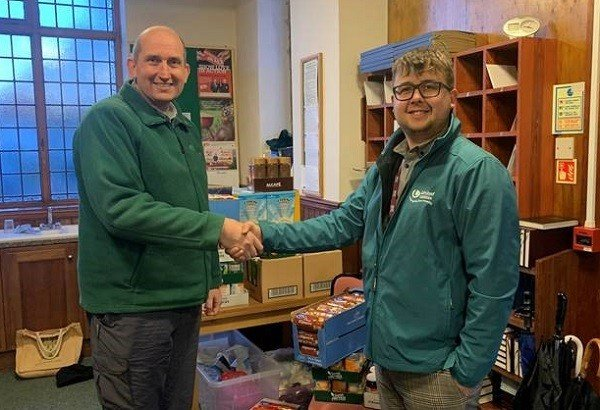 L-R: Andrew Robinson and Luke Johnston at the North Lakes Foodbank with the donation of provisions from staff at United Utilities