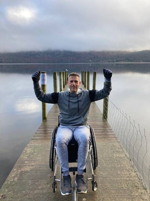 A 46-year-old disabled dad has overcome the odds and the elements to complete a wheelchair version of the trek from Land's End to John O'Groats on Cumbria's roads.