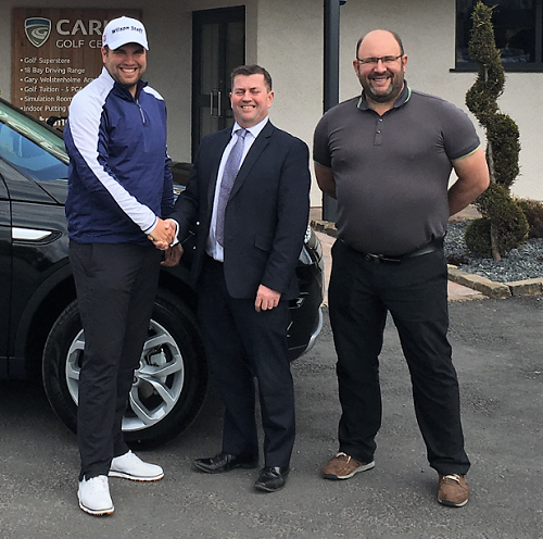 Kenny Curran from Kentdale (centre) presenting a new Land Rover Discovery Sport to Jack Senior (left); with Graham Curtin (right)