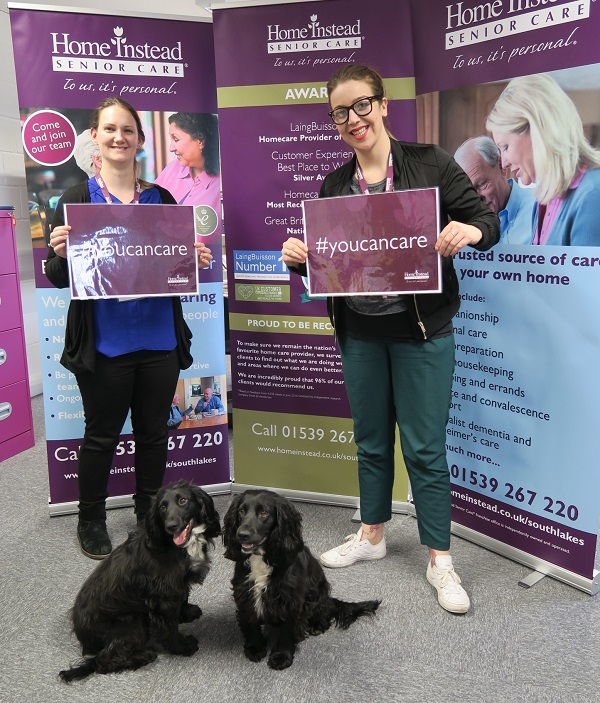 Care Manager Sophie Cammaerts and CAREGivers Faye Donoghue with office dogs Megan and Darcy