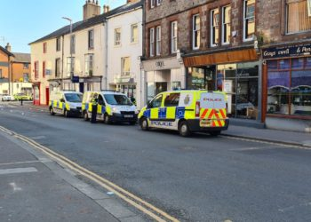 Police attend King Street in Penrith on Monday