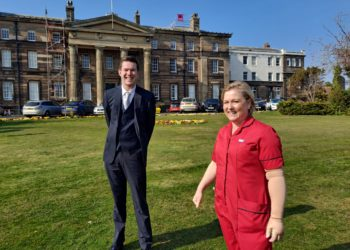 Cameron Stewart and Chief Nurse Anna Stabler outside the Cumberland Infirmary