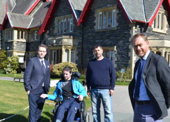 Tim Farron at Holehird with resident Nathan Johnston and Nathan's brother Gavin and father Kevin