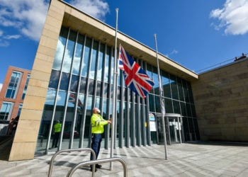 Following the announcement at the death of His Royal Highness Prince Philip The Duke of Edinburgh, the Union Flag is lowered outside Cumbria House, Headquarters of Cumbria County Council in Carlisle: 9 April 2021