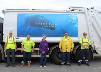 Copeland recycling staff with one of their newly-liveried lorries