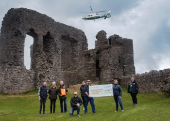 Herdy donation presentation at Kendal Castle, complete with the new Great North Air Ambulance helicopter flying above.