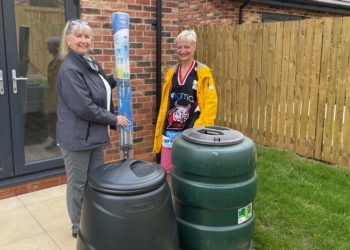 Genesis Homes sales executive Pam Oates (left) presents homebuyer Marjorie Chamberlain with an eco pack for her new home in Beckstones, Rheda North Park.