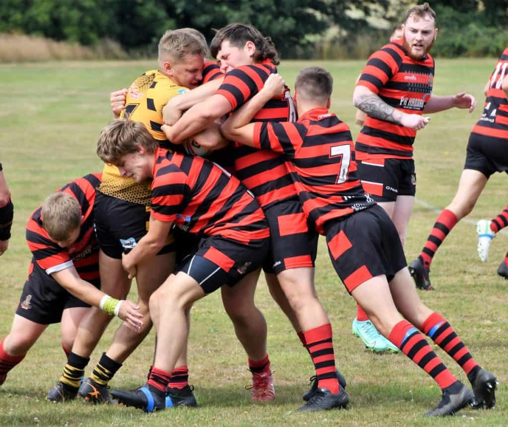 Hensingham pile in for the tackle.