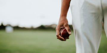 Cricket bowler holding cricket ball