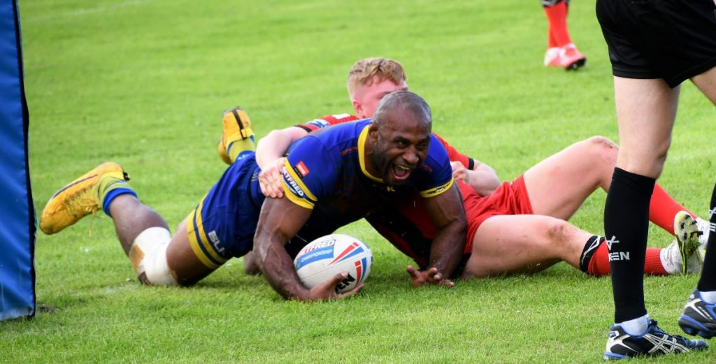 Dion Aiye powers his way over for Whitehaven (Ben Challis)