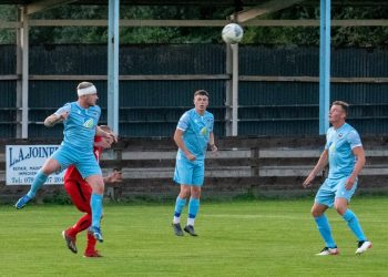 Bandaged Jack Brannan heads clear for Carlisle City against Tow Law