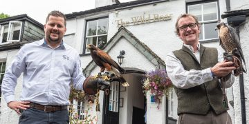 Adam Bujok (left) from the Wild Boar Inn with Harris Hawk Popeye and Stephen Lea from Lake District Falconry with Peregrine Falcon Dot