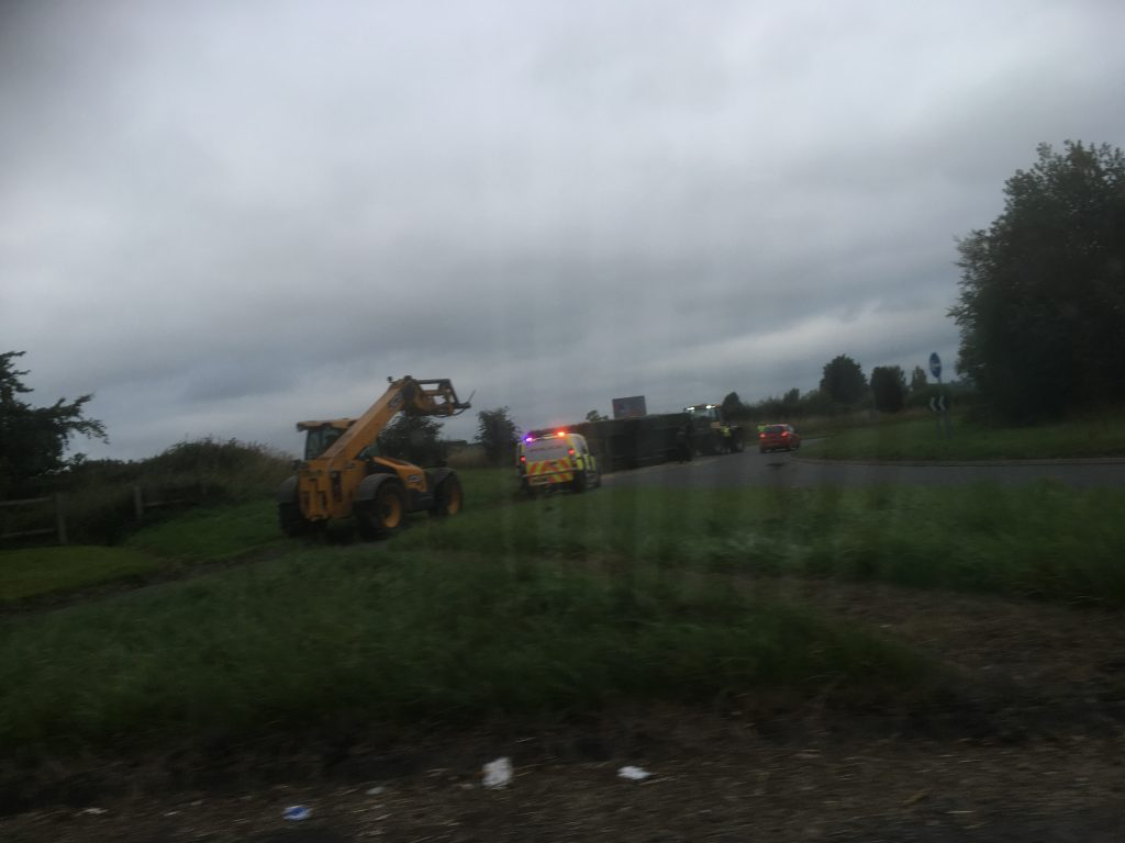 A tractor has shed a trailer full of hay on a roundabout near Penrith.