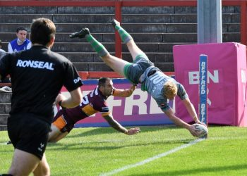 Lachlan Walmsley dives in for his second try (Ben Challis)