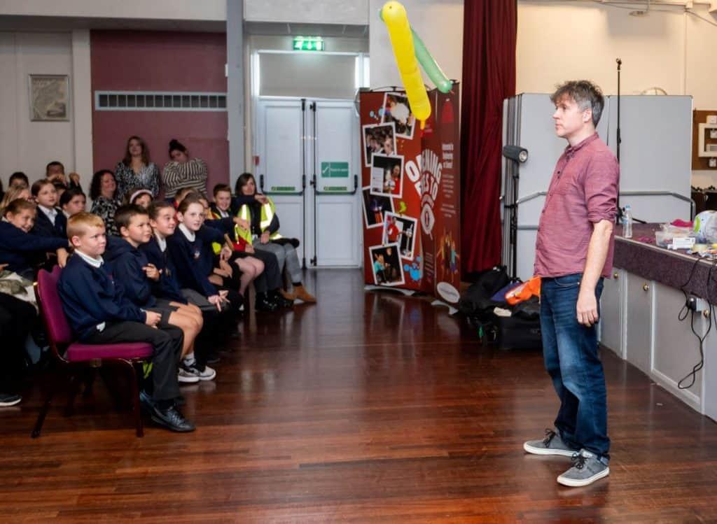 Simon Watt captivates his audience of primary schoolchildren with his experiments
