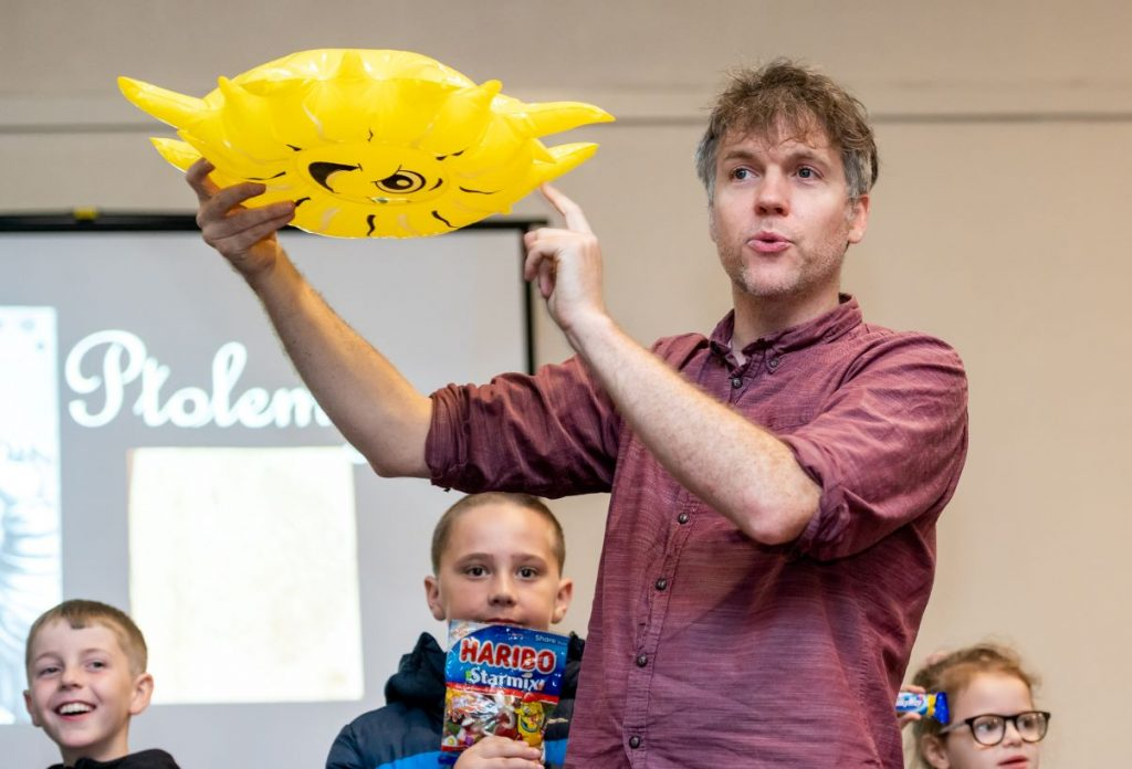 Simon Watt engages with pupils as he teaches them about the universe