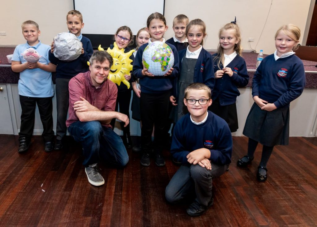 Simon Watt with pupils at Montreal Church of England Primary School