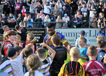 Young fans surround Jesse Joe Parker at the end of the win over Halifax (Ben Challis)