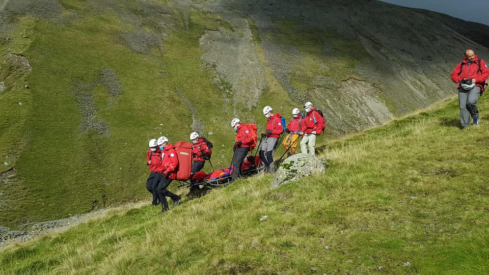 A woman was stretchered off Scafell Pike after breaking her ankle.
