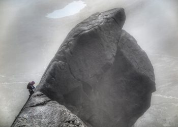 Anna Taylor tackles the final section of Cioch Nose on Skye as the rain falls - photo credit Neil Gresham