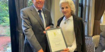 Frank Musker receives his award
