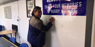 Workington Town legend Hitro Okesene signs the memory board