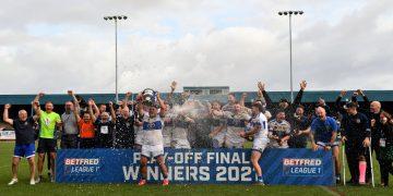 Workington captain Jamie Doran lifts the League One Play-off trophy (Ben Challis)