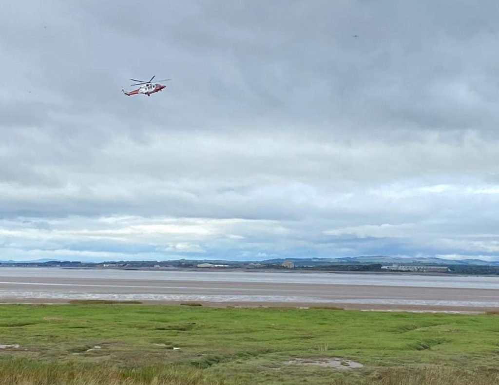 A man became stuck thigh-high in mud as the tide rose close to Port Carlisle.