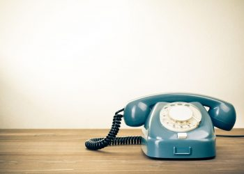 blue telephone on a table