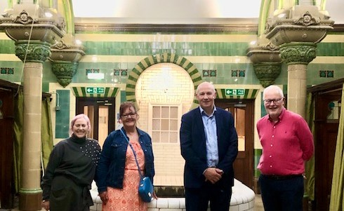 A family connection has been revealed which links the chairwoman of a campaign group to the baths which she supports.